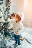 Two girls with santa hat laying in front of the christmas tree. Two Young Girls havung fun In Front Of Christmas Tree Stock Photography
