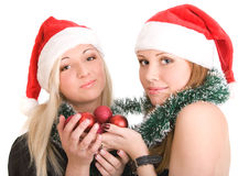 Two girls in Santa hats Royalty Free Stock Image