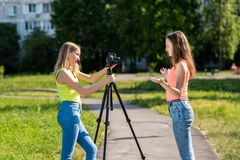 Two girls schoolgirl. Summer in the city. Record the broadcast. Record vlog and blog. Record video lesson for Internet stock photo