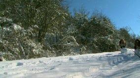 Two Girls Sculpt Snowman stock video footage