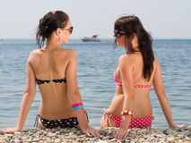 Two girls at the sea Royalty Free Stock Photos