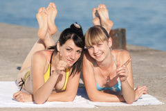 Two girls at the sea Stock Images