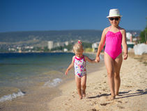 Two girls on sea coast Royalty Free Stock Photos