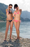 Two girls on seashore Royalty Free Stock Image