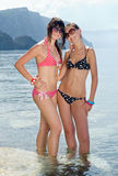 Two girls on seashore Stock Photos