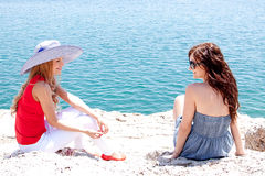 Two girls at the seaside Stock Photo