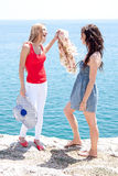 Two girls at the seaside Stock Photography