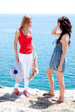 Two girls at the seaside Royalty Free Stock Images