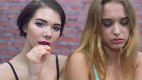 Two girls sexy eat fresh red garnet in underwear. Juice. Bite lip. Enjoyment. Model, fashion stock footage
