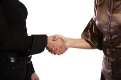 Two girls shaking hands Stock Photography
