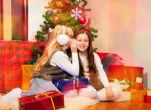 Two girls sharing secrets Royalty Free Stock Images