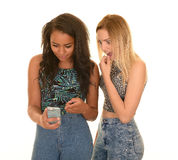 Two girls shocked by phone message Royalty Free Stock Images