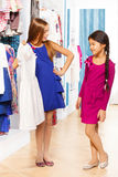Two girls shop and one asks other about the dress Royalty Free Stock Image