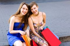 Two girls with shopping bags Royalty Free Stock Photography