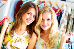 Two girls with shopping bags. Two beautiful girls out shopping stock image