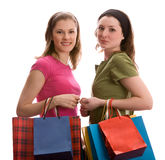Two girls with shopping bags. Isolated on white. Royalty Free Stock Photography