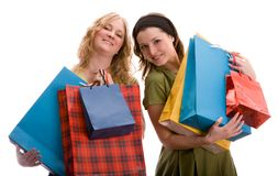 Two girls with shopping bags. Isolated on white. Stock Photography