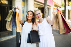 Two girls with shopping bags outdoors Stock Image