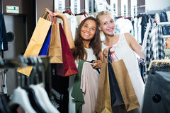 Two girls shopping clothes Royalty Free Stock Photos