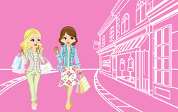 Two girls Shopping in the small town Stock Photography