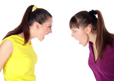 Two girls shouting at each other Stock Photo