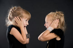 Two girls shouting at each other Stock Photography