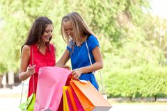 Two girls show each other the purchase Royalty Free Stock Image