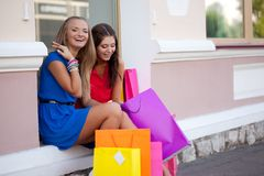 Two girls show each other the purchase Stock Photo