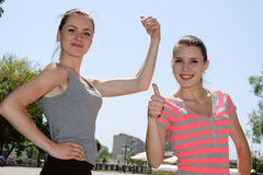 Two girls show what they are strong Stock Image