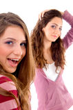Two girls showing happiness together Stock Photos