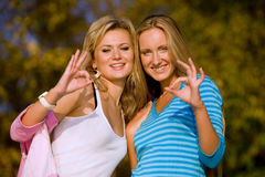 Two girls showing O.K. Royalty Free Stock Photo