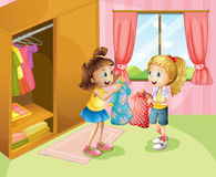 Two girls showing their clothes inside the house Stock Photography