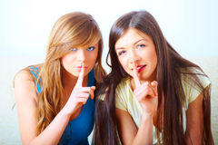 Two girls shushing Royalty Free Stock Photography