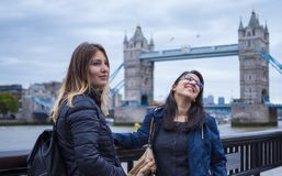 Two girls on a sightseeing trip to London. Travel photography stock image