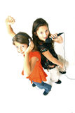 Two girls singing. Two young girls singing and listening to music Stock Photo