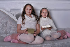 Two  girls sister with gifts in hands Stock Photo