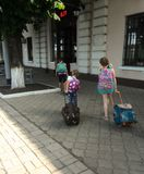 Two girls of the sister go with bags to the station. royalty free stock image