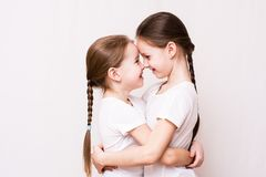 Two girls sisters gently hug each other when meeting. Domestic life stock photos