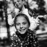 Two girls sisters or girlfriends having fun outdoors. Black and white royalty free stock photography