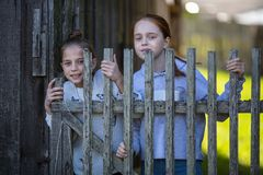 Two girls sisters or girlfriends having fun outdoors at Village. Royalty Free Stock Images