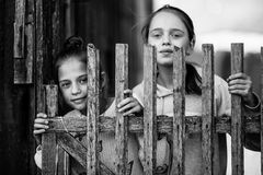 Two girls sisters or girlfriends having fun outdoors at Village. Looking into the camera. Black and white photo royalty free stock photography