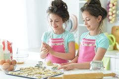 Portrait of a two girls in the kitchen stock image