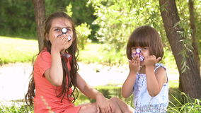 Two girls sisters playing with fidget spinner, slow motion. Two girls sisters playing with fidget spinner, slow motion stock footage
