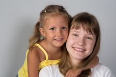 Two girls sisters teenager and child royalty free stock photo