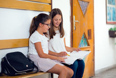Two girls sit in the hallway school Stock Photography