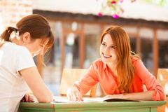Two girls sitting in the cafe Stock Image