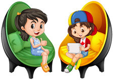 Two girls sitting on chairs Stock Images