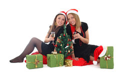 Two girls sitting and drinking champagne Royalty Free Stock Photography