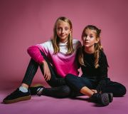 Two Girls Sitting on Floor royalty free stock images