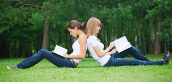 Two girls sitting on the grass Royalty Free Stock Photography